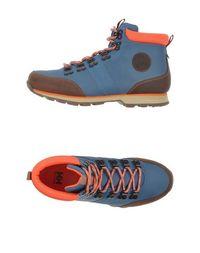 Полусапоги и высокие ботинки Helly Hansen