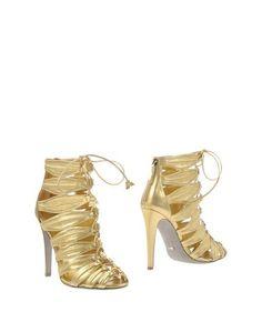 Золотистые Полусапоги и высокие ботинки Sergio Rossi