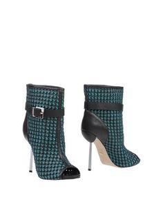 Черные Полусапоги и высокие ботинки Sergio Rossi