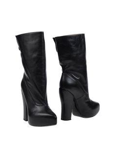 Черные Полусапоги и высокие ботинки Carven