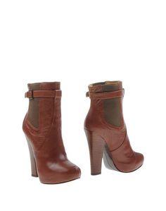 Коричневые Полусапоги и высокие ботинки Nine West