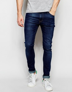 Выбеленные супероблегающие джинсы темного цвета ASOS - Синий