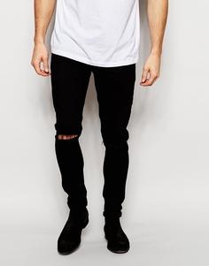 Ультразауженные джинсы скинни с рваными коленями ASOS - Черный