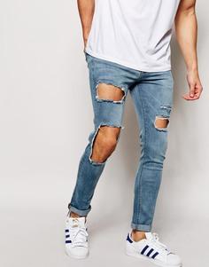 Супероблегающие джинсы с большими дырками ASOS - Светло-голубой