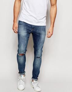 Ультразауженные джинсы скинни с рваными коленями ASOS - Умеренный синий