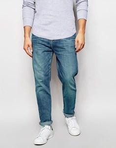 Суженные книзу выбеленные джинсы ASOS - Умеренный синий