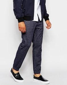 Элегантные зауженные спортивные брюки из первосортной ткани ASOS - Темно-синий