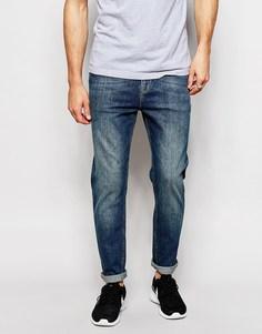 Эластичные суженные книзу джинсы ASOS - Умеренный синий