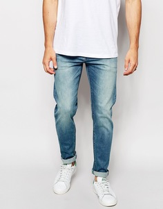 Эластичные узкие джинсы ASOS - Умеренный синий