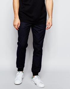 Спортивные штаны слим в полоску ASOS - Темно-синий