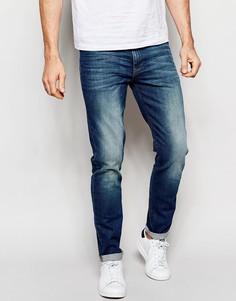 Зауженные джинсы с потертостями ASOS - Умеренный синий