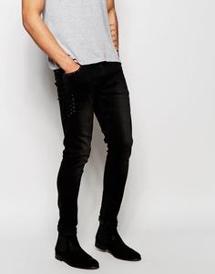 Супероблегающие джинсы с заклепками на карманах ASOS - Черный