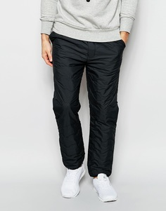 Стеганые суженные тренировочные брюки Levi's California - Серый