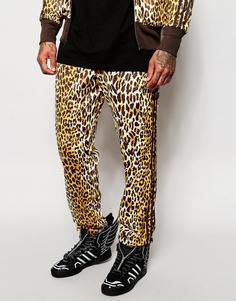 Спортивные штаны с леопардовым принтом adidas Originals X Jeremy Scott - Коричневый