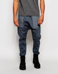 Спортивные штаны с карманами и заниженным шаговым швом ASOS - Petrol blue
