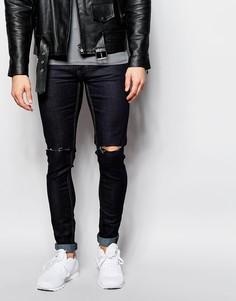 Окрашенные спреем рваные джинсы скинни Religion - Темный индиго