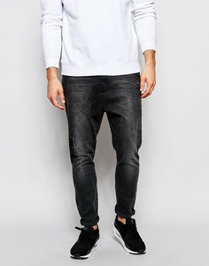 Рваные потертые джинсы черного цвета с заниженным шаговым швом ASOS - Выбеленный черный