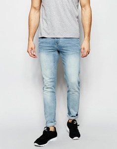 Светлые джинсы скинни с выбеленным эффектом ASOS - Светло-голубой