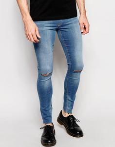 Джинсовые меггинсы с рваными коленками ASOS - Умеренный синий