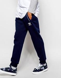 Зауженные спортивные штаны с принтом Chaos adidas Originals Superstar - Темно-синий