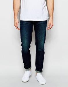 Суженные книзу темные джинсы с эффектом поношенности Levis 511 - Biology Levi's®