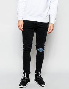 Черные выбеленные суперузкие джинсы с прорехами и нашивками ASOS - Выбеленный черный