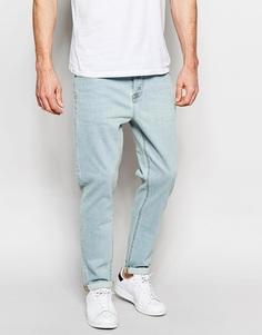 Светло-голубые эластичные джинсы с зауженными книзу штанинами ASOS - Выбеленный синий
