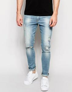 Голубые выбеленные супероблегающие джинсы с заплатками ASOS - Выбеленный синий
