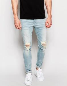 Голубые выбеленные супероблегающие джинсы с рваными коленками ASOS - Выбеленный синий