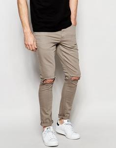 Ультразауженные серые джинсы скинни с рваными коленями ASOS - Серый сланец
