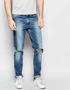 Рваные зауженные джинсы с потертостями ASOS - Синий выбеленный