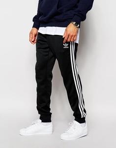 Спортивные штаны с манжетами adidas Originals Superstar AJ6960 - Черный