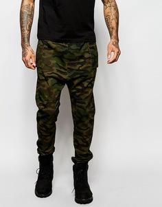 Камуфляжные спортивные штаны с заниженным шаговым швом ASOS - Хаки