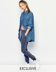 Трикотажные брюки с манжетами и лампасами Ellesse - Синий меланж