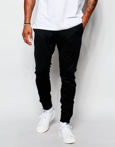 Зауженные джинсы Nike FC Libero 718975-010 - Черный