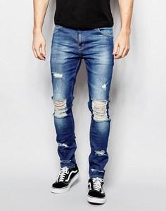 Супероблегающие джинсы с рваными коленями ASOS - Умеренный синий