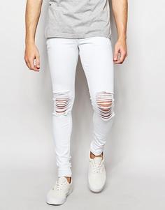 Супероблегающие джинсы с рваными коленями ASOS - Выбеленный синий