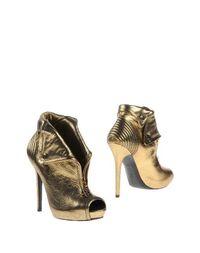 Золотистые Полусапоги и высокие ботинки Alexander Mcqueen