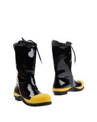 Черные Полусапоги и высокие ботинки MIU MIU