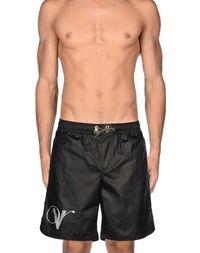 Пляжные брюки и шорты Golden Goose