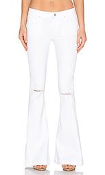 Рваные ультра расклёшенные джинсы madison - AGOLDE