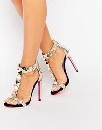 Черно-золотистые сандалии на каблуке с пирамидальной отделкой Carvela
