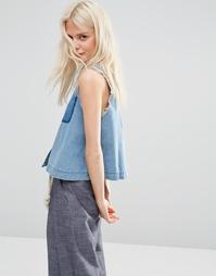 Джинсовая рубашка без рукавов с необработанным краем ASOS