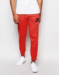 Красные спортивные брюки зауженного кроя Nike AW77 727369-672