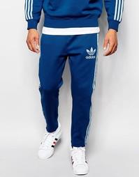 Синие спортивные штаны с фирменной отделкой adidas Originals B10670