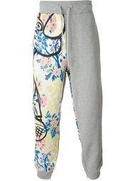 спортивные брюки с цветочным принтом Moschino