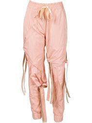 спортивные брюки с ремешками Nicopanda
