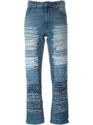 джинсы с потертой отделкой Alexander McQueen