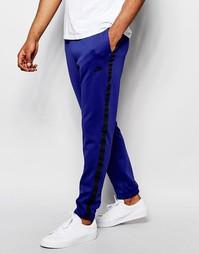 Темно-синие зауженные джоггеры Nike Tribute 678637-455 - Темно-синий