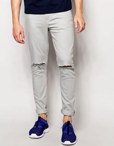 Светло-синие супероблегающие джинсы с рваными коленками ASOS